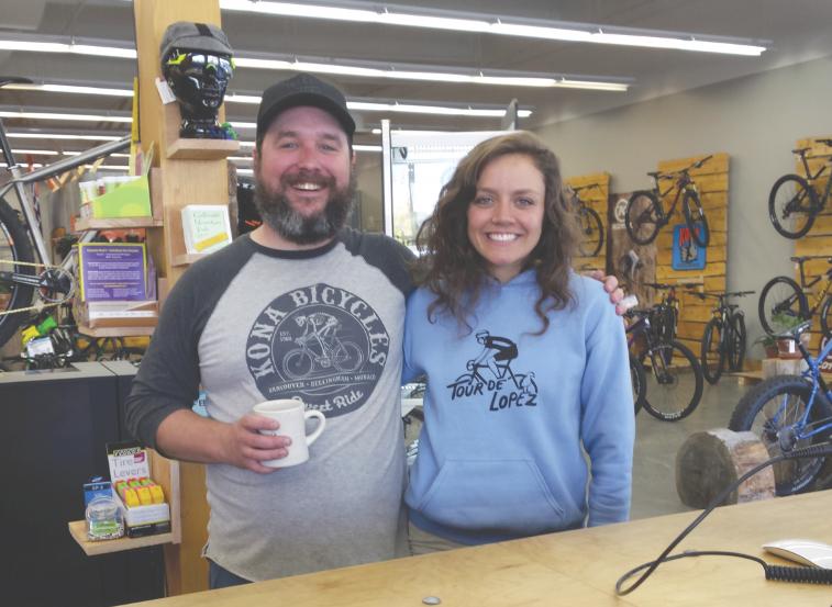 Matt Hoffmeyer and Amanda Bryant in the new Kona shop in Bellingham.