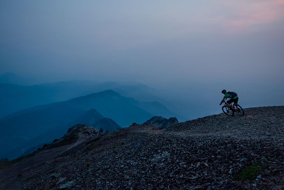 Bob Jones riding on Mount Cheam near Chilliwack, B.C., above smoke from the Alaho Fire. Reuben Krabbe photo.